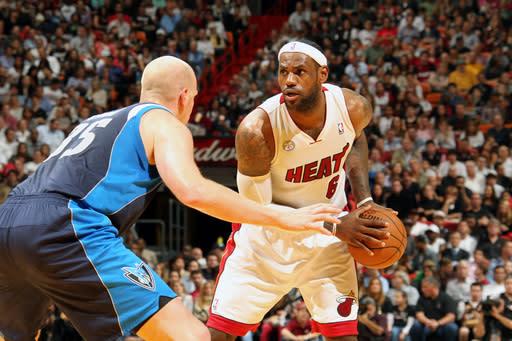 James scores 32, Heat beat Mavs in OT, 119-109