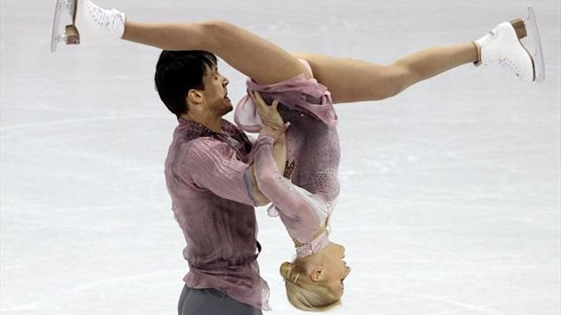 Tatiana Volosozhar (R) and Maxim Trankov of Russia perform their free skating program at the ISU World Figure Skating Championships