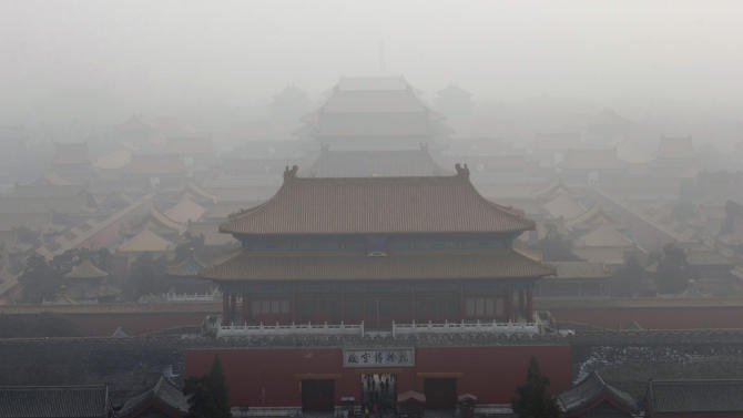 Visitors gather near an entrance to the Forbidden city during a very hazy day in Beijing Sunday, Jan. 13, 2013. People refused to venture outdoors and buildings disappeared into Beijing's murky skyline on Sunday as the capital's air quality went off the index. (AP Photo/Ng Han Guan)