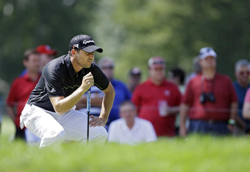 Sergio Garcia, from Spain, looks over a putt on the eighth green during the first round of the Bridgestone Invitational golf tournament Thursday, Aug. 1, 2013, at Firestone Country Club in Akron, Ohio. (AP Photo/Mark Duncan)