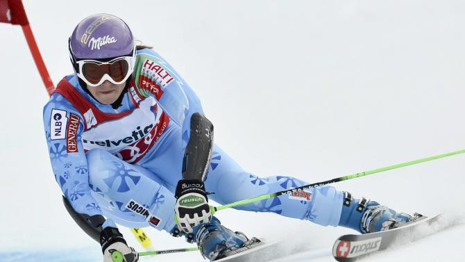 Tina Maze of Slovenia speeds down the slope during the 1st run of the women's World Cup Giant Slalom at the FIS Alpine Ski World Cup finals, in  Lenzerheide, Switzerland, Sunday, March 17, 2013. (AP Photo/Keystone/Peter Schneider)