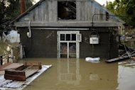 A flooded house stands in the southern Russian town of Krymsk. First funerals were held in the town of Krymsk, the worst hit area in southern Krasnodar region, as emergency workers pulled more bodies from the debris and survivors insisted they had not received any flood warning. (AFP Photo/Mikhail Mordasov)