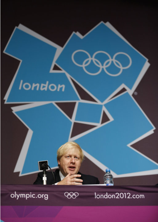 London mayor Boris Johnson speaks during a news conference before the start of a media opportunity at the Olympic and Paralympic athlete's village in London, Thursday, July 12, 2012.  The London Olymp