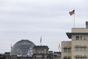 A U.S. flag flies atop the U.S.embassy next to the Reichstag building, seat of the German lower house of parliament Bundestag in Berlin