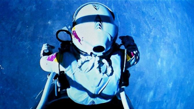 This image taken from a video monitor, provided by Red Bull Stratos, shows pilot Felix Baumgartner of Austria before he jumps out of the capsule during the final manned flight for Red Bull Stratos on Sunday, Oct. 14, 2012. In a giant leap from more than 24 miles up, Baumgartner shattered the sound barrier Sunday while making the highest jump ever — a tumbling, death-defying plunge from a balloon to a safe landing in the New Mexico desert. (AP Photo/Red Bull Stratos, Jay Nemeth)