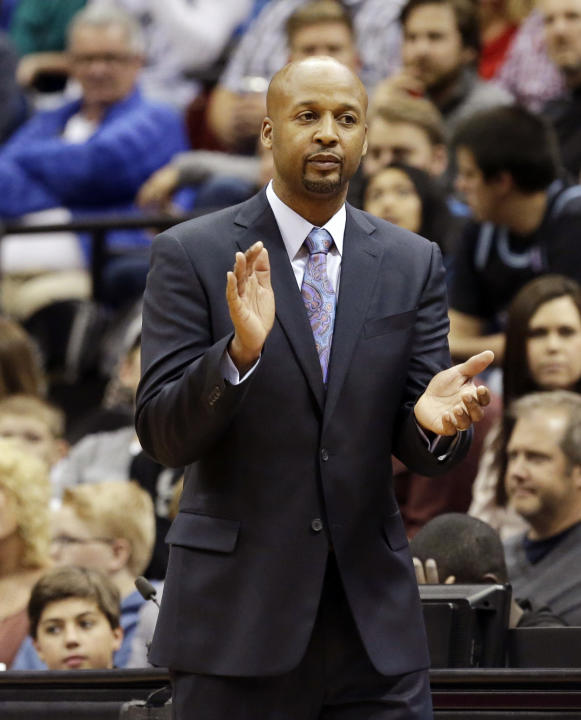 Denver Nuggets head coach Brian Shaw applauds his players in the second half of an NBA basketball game against the Minnesota Timberwolves, Wednesday, Nov. 27, 2013, in Minneapolis. The Nuggets won 117