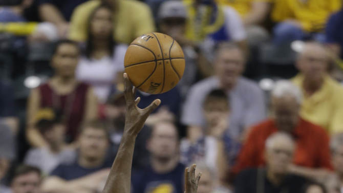 Indiana Pacers' Roy Hibbert (55) shoots over Atlanta Hawks' Ivan Johnson during the first half of Game 5 in the first round of the NBA basketball playoff series on Wednesday, May 1, 2013, in Indianapolis. (AP Photo/Darron Cummings)