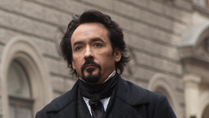 """In this film publicity image released by Relativity Media, John Cusack portrays Edgar Allan Poe in a scene from the gothic thriller """"The Raven."""" (AP Photo/Relativity Media, Larry Horricks)"""