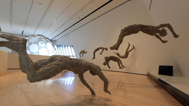 In this Nov. 9, 2012 Chen Quilin's Floating series is displayed at the Eli and Edythe Broad Art Museum on Michigan State University's campus in East Lansing, Mich. (AP Photo/Carlos Osorio)
