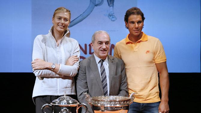 (From L) Russian tennis player Maria Sharapova, President of the French Tennis Federation Jean Gachassin, and Spanish player Rafael Nadal, seen at the draw for the first round of the French Open in Paris on May 22, 2015
