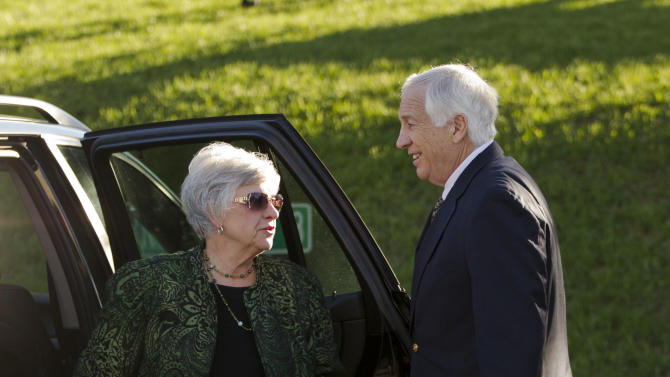 Jerry Sandusky, a former Penn State assistant football coach charged with sexually abusing boys, accompanied by his wife Dottie Sandusky arrives at the Centre County Courthouse in Thursday, April 5, 2012, in Bellefonte. (AP Photo/Matt Rourke)