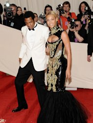 FILE -- In a may 2, 2011 file photo Beyonce Knowles and her husband Jay-Z arrive at the Metropolitan Museum of Art Costume Institute gala in New York. Beyonc and Jay-Z enjoyed a concert by R&B singer The-Dream Sunday March 11, 2012 in New York. (AP Photo/Evan Agostini)