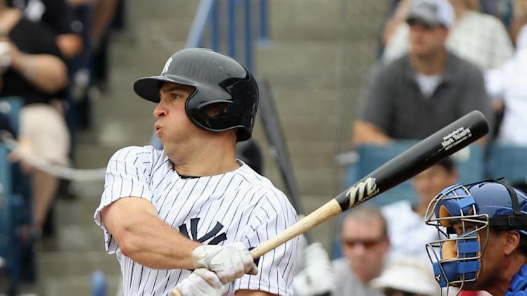 February 24, 2013; Tampa, FL, USA; New York Yankees first baseman Mark Teixeira (25) singles in the first inning against the Toronto Blue Jays at George M. Steinbrenner Field. (Kim Klement-USA TODAY Sports)