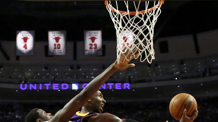 Los Angeles Lakers guard Kobe Bryant, right, shoots a reverse lay up past Chicago Bulls center Nazr Mohammed (48) during the second half of an NBA basketball game Monday, Jan. 21, 2013, in Chicago. The Bulls won 95-83. (AP Photo/Charles Rex Arbogast)