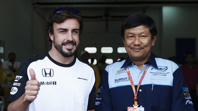 Formula One - F1: McLaren's Fernando Alonso (L) gestures while leaving the medical  centre
