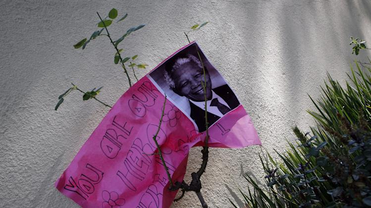 A get well message placed outside the home of the former President Mandela in Johannesburg, South Africa, Sunday, June 16, 2013. The 94-year-old Mandela remains in the hospital for an eighth day, after being hospitalized for a recurring lung infection. (AP Photo/Themba Hadebe)