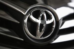 File photo of a Toyota logo on a car inside a showroom at a Toyota dealership in Warsaw