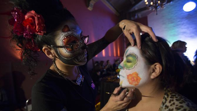 Make-up artist Livier applies make-up on Granados at a press reception ahead of the 15th annual Dia de los Muertos, or Day of the Dead, festival at Hollywood Forever Cemetery in Los Angeles