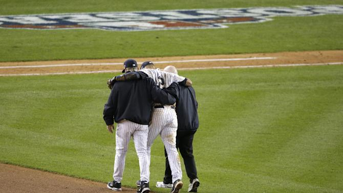 Trainer Steve Donohue, right, and New York Yankees manager Joe Girardi, left, help Yankees' Derek Jeter off the field after he injured himself during Game 1 of the American League championship series against the Detroit Tigers Sunday, Oct. 14, 2012, in New York. (AP Photo/Charlie Riedel)