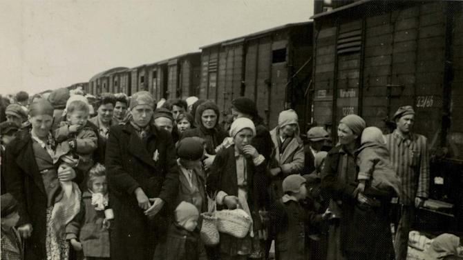 """In this May 1944 photo provided by Yad Vashem Photo Archives, Jewish women and children deported from Hungary, separated from the men, line up for selection on the selection platform at Auschwitz camp in Birkenau, Poland. Johann """"Hans"""" Breyer, 87, of Philadelphia admits he was a guard at Auschwitz, but says he was never in Auschwitz-Birkenau, the part of the death camp used as a killing machine for Jews. World-War II-era documents obtained by The Associated Press indicate otherwise. Those files are now in the hands of German authorities, and could provide the legal basis for charging Breyer as an accessory to the murder of hundreds of thousands of Jews in the Nazi death camp. (AP Photo/Yad Vashem Photo Archives)"""