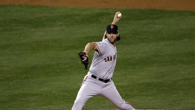 San Francisco Giants pitcher Madison Bumgarner throws during the first inning of Game 1 of baseball's World Series against the Kansas City Royals Tuesday, Oct. 21, 2014, in Kansas City, Mo. (AP Photo/Jeff Roberson)