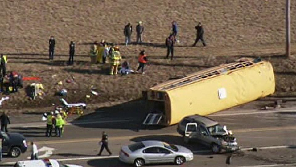 Emergency personnel respond at the scene where a school bus overturned that was carrying about two dozen elementary school children, Friday, April 5, 2013, in Wadsworh, Ill. Lake County Sheriff's Office spokeswoman Sgt. Sara Balmes says there was no immediate word on any injuries. (AP Photo/Courtesy of NBCChicago.com) TELEVISION OUT
