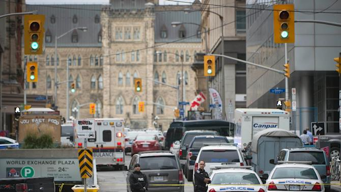 The main street leading to the Parliament buildings in Ottawa, Ontario are filled with police after multiple shootings on October 22, 2014