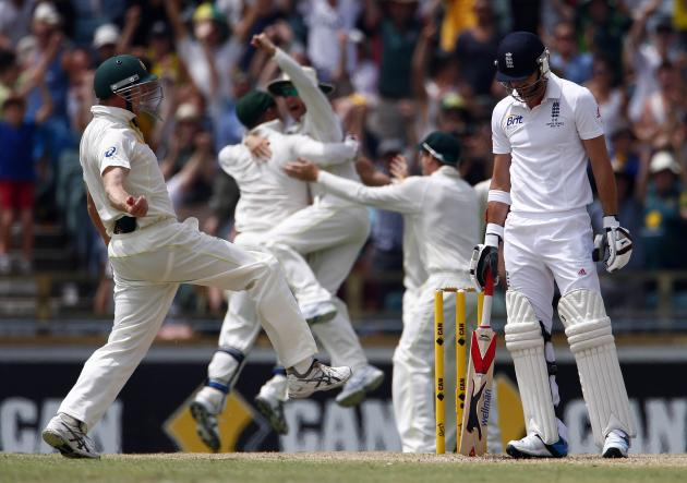 Australia's George Bailey celebrates with teammates after taking the final catch to dismiss England's James Anderson and win their Ashes test cricket series at the WACA ground in Perth