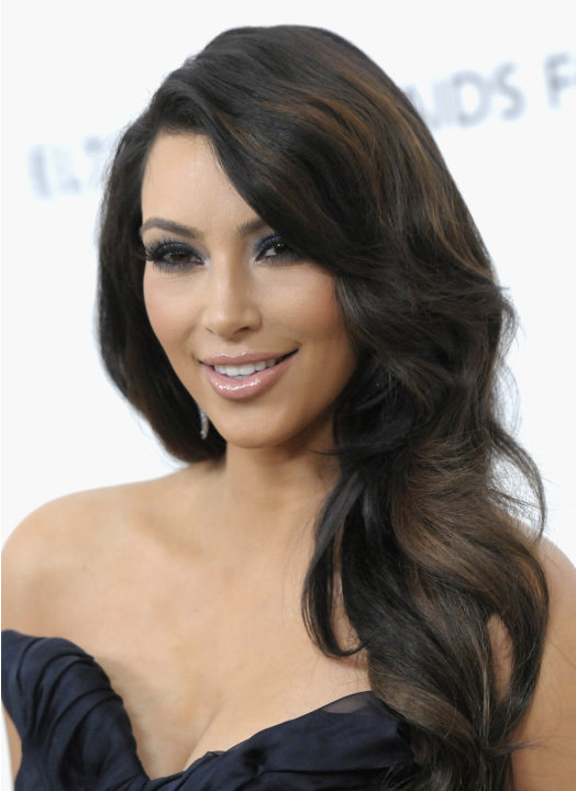 FILE - In this Feb. 27, 2011 file photo, television personality Kim Kardashian arrives at the 2011 Elton John Academy Award viewing party in West Hollywood, Calif.  Kardashian on Wednesday, July 2011