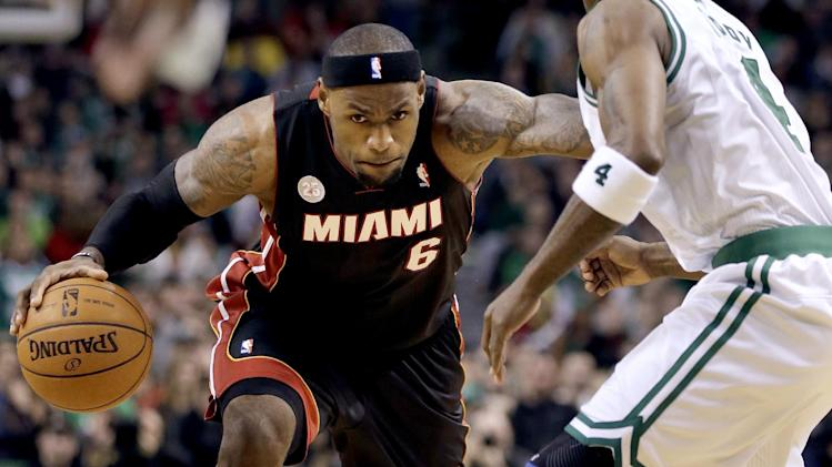Miami Heat forward LeBron James (6) looks for an opening past Boston Celtics guard Jason Terry (4) during overtime of an NBA basketball game at TD Garden in Boston, Sunday, Jan. 27, 2013. The Celtics won 100-98 in double overtime. (AP Photo/Steven Senne)