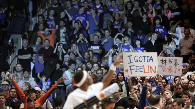 Fans hold signs in support of New York Knicks' Jeremy Lin during the second half of an NBA basketball game against the Dallas Mavericks in New York, Sunday, Feb. 19, 2012. The Knicks defeated the Mavericks 104-97. (AP Photo/Seth Wenig)