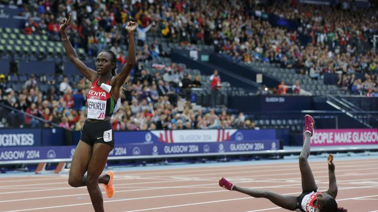 Chepkirui of Kenya takes first place ahead of compatriot Kiplagat, who fell on the track in the Women's 10000m final at the Commonwealth Games in Glasgow