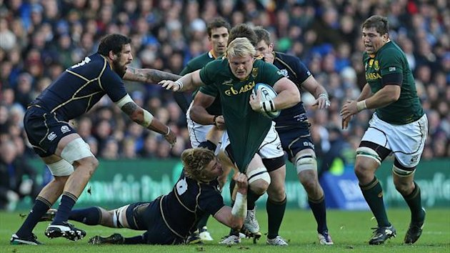 South Africa's hooker Adriaan Strauss (3rd R) heads for the try line during the International rugby union test match between Scotland and South Africa at Murrayfield in Edinburgh