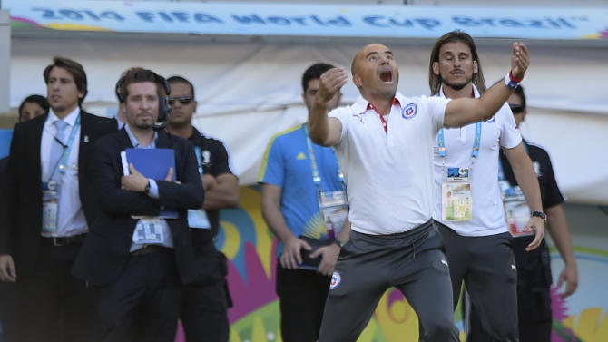 Chile's Argentinian coach Jorge Sampaoli reacts during extra-time at the football match between Brazil and Chile at the Mineirao Stadium in Belo Horizonte during the 2014 FIFA World Cup on June 28, 2014