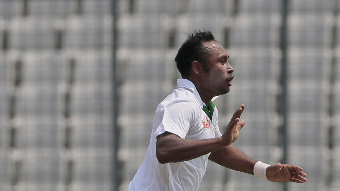 Bangladesh's Mohammad Shahid celebrates the dismissal of Pakistan's Mohammad Hafeez during their second international test cricket match in Dhaka, Bangladesh, Wednesday, May 6, 2015. (AP Photo/ A.M. Ahad)