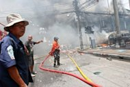 Thai rescue workers extinguish a fire at the site of a car bomb blast in Thailand's southern restive province of Yala. Three bomb attacks minutes apart killed 10 people and wounded more than 100 in the main town in Thailand's insurgency-hit far south