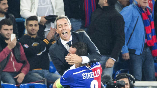Basel's Portuguese head coach Paulo Sousa, celebrates the 1-0 victory with Marco Streller, after the Champions League Group B soccer match between FC Basel 1893 and Liverpool FC, at the St. Jakob-Park stadium in Basel, Switzerland, on Wednesday, Oct. 1, 2014. (AP Photo/Keystone, Patrick Straub)
