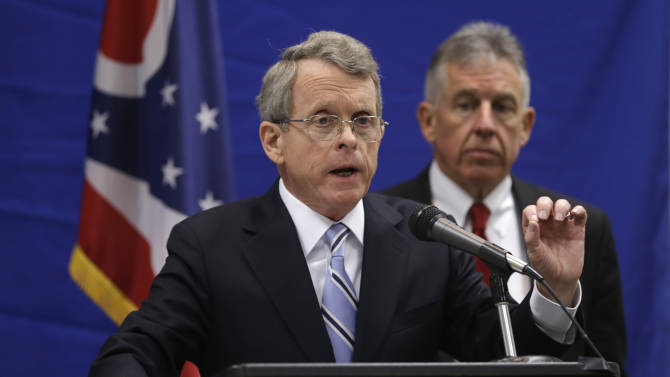 Ohio Attorney General Mike DeWine answers questions during a news-conference at the Bureau of Criminal Investigation Tuesday, Feb. 5, 2013, in Richfield, Ohio. Cuyahoga County prosecutor Tim McGinty, right, listens. DeWine said the lack of proper supervision and failures in the system led to a chaotic police chase with 13 officers firing 137 rounds, killing two people. DeWine released the first detailed account of the Nov. 29, 2012 shooting. He turned it over to McGinty who said the case will be presented to a grand jury to determine if the officers should face charges. (AP Photo/Tony Dejak)