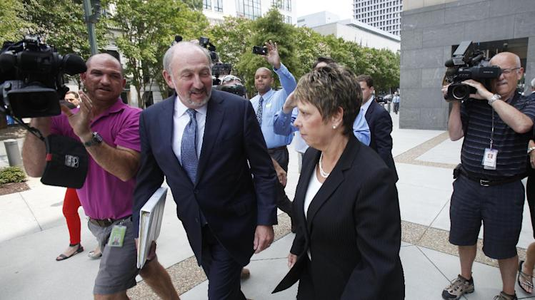 Jerri Fulkerson, right, Jonnie Williams's assistant, and her attorney George Terwilliger leave federal court after completing her testimony in the corruption trial of former Virginia Gov. Bob McDonnell and his wife Maureen, Wednesday, July 30, 2014 in Richmond, Va. (AP Photo/Richmond Times-Dispatch, James H. Wallace)