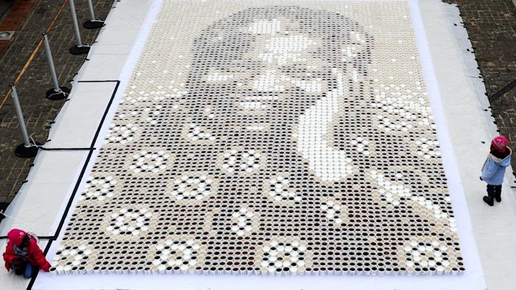 "In this photo taken Saturday, July 14, 2012 a mosaic of various coffees make up a giant mosaic portrait of former South African President Nelson Mandela, affectionately know as ""Madiba""  in Johannesburg. The event took place in celebration of Mandela's 94th birthday which takes place Wednesday, July 18, 2012. (AP Photo)"