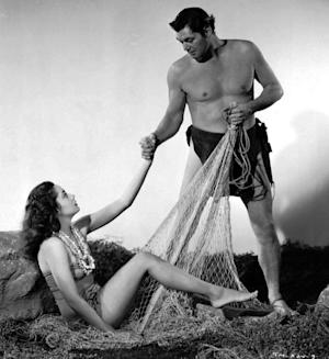 "FILE - In this 1948 file photo, actress Linda Christian appears with Johnny Weissmuller as Tarzan in ""Tarzan And The Mermaids."" Christian, the Hollywood starlet of the 1940s and went on to become the first Bond girl, has died. Her daughter, Romina Power, says Christian died Friday, July 22, 2011, in Palm Desert, Calif. after battling colon cancer. She was 87. (AP Photo)"
