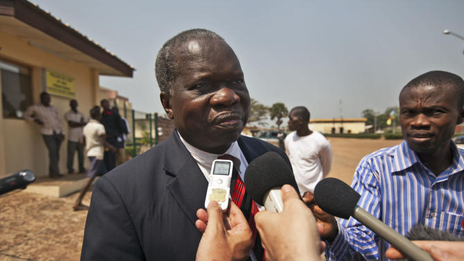 Head of the Central African Republic's government delegation to the peace talks, Jean Willybiro Sako, speaks to the media at the airport in Bangui, Central African Republic Monday, Jan. 7, 2013. Delegations representing Central African Republic's government and the rebels who now control much of the country's north were to head Monday to hold peace talks in Libreville, Gabon, though already there are concerns about what will happen if those negotiations fail. (AP Photo/Ben Curtis)