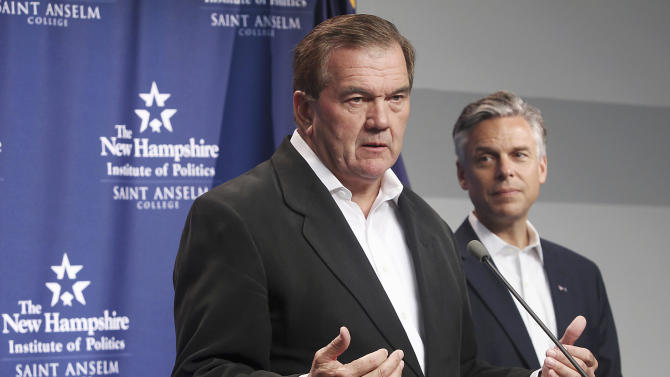 FILE - In this Sept. 16, 2011 file photo, former Pennsylvania Gov. and Homeland Security Secretary Tom Ridge, left, gestures while speaking with Republican presidential candidate, former Utah Gov. Jon Huntsman in Manchester N.H. When they can't be in New Hampshire, Iowa and other early voting states, presidential hopefuls traditionally have sent others in their stead.  (AP Photo/Cheryl Senter, File)