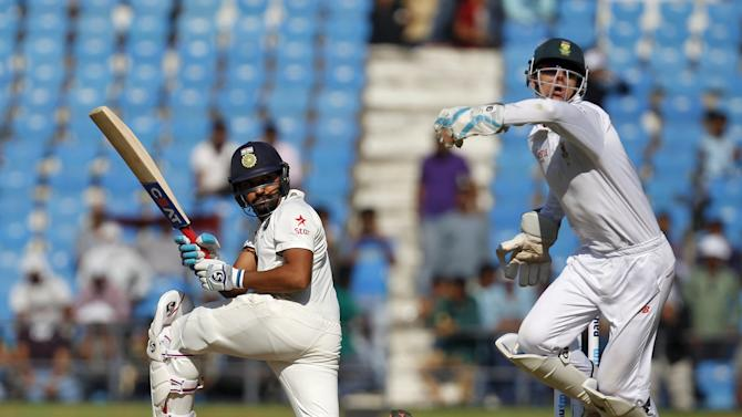India's Sharma plays a shot past South Africa's wicketkeeper Vilas during the second day of their third test cricket match in Nagpur
