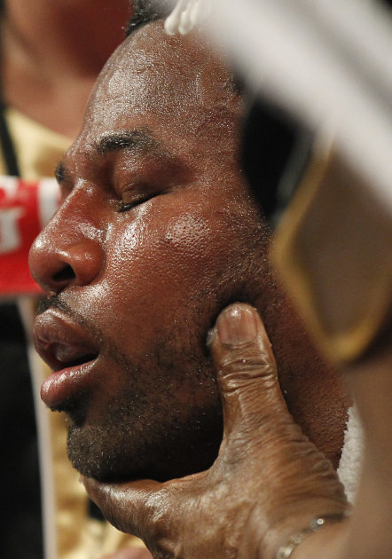 Shane Mosley is worked on by his trainers during a WBO welterweight title bout against Manny Pacquiao,  Saturday, May 7, 2011, in Las Vegas.  (AP Photo/Isaac Brekken)