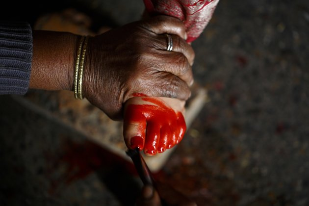 A foot of a Newar girl is painted red before performing rituals during an Ihi ceremony in Kathmandu