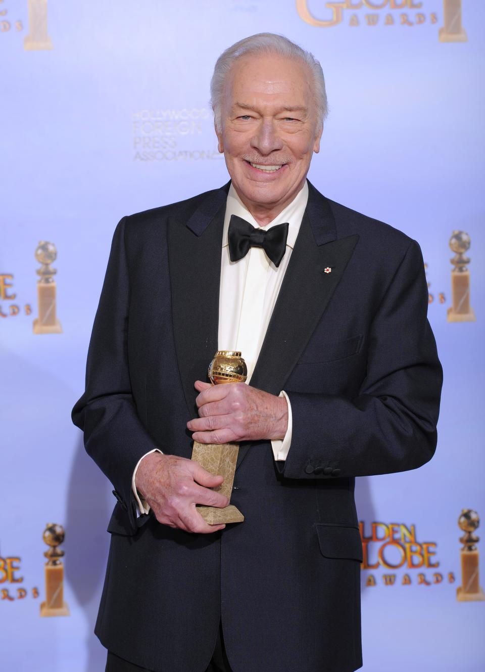 "Actor Christopher Plummer poses backstage with the award for Best Supporting Actor in a Motion Picture for the film "" Beginners"" during the 69th Annual Golden Globe Awards Sunday, Jan. 15, 2012, in Los Angeles. (AP Photo/Mark J. Terrill)"