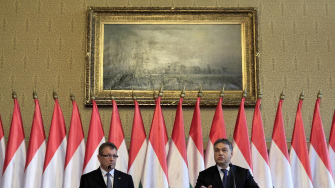 Hungarian Prime Minister Orban and Hungary's central bank Governor Matolcsy hold a joint news conference in Budapest