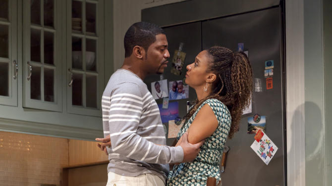 """In this theater publicity image released by Boneau/Bryan-Brown, Mekhi Phifer, left, and Tracie Thoms are shown in a scene from """"Stick Fly,"""" at the Cort Theatre in New York. (AP Photo/Boneau/Bryan-Brown, Richard Termine)"""
