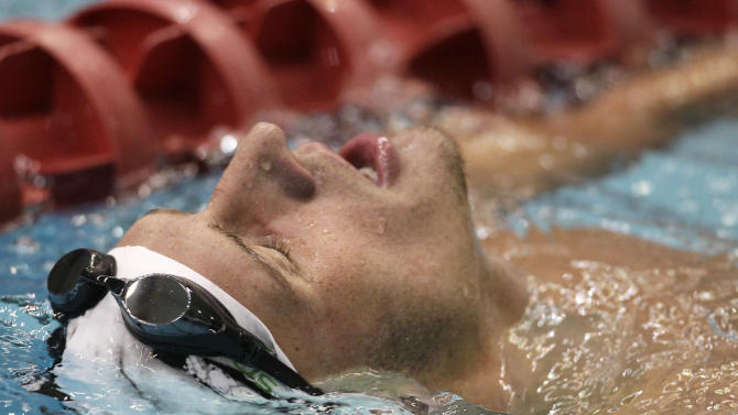 Ryan Lochte reacts after winning the men's 200-meter backstroke at the USA Swimming Grand Prix swim meet in Indianapolis, Saturday, March 5, 2011. Lochte won the event with a time of 1:57.63. (AP Photo/Darron Cummings)